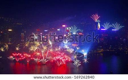 HONG KONG - 1 JANUARY: A splendid firework show and countdown celebration held in Hong Kong on 1 January, 2014. The show lasted for 8 minutes and lighted up the skies above Hong Kong skyscrapers.