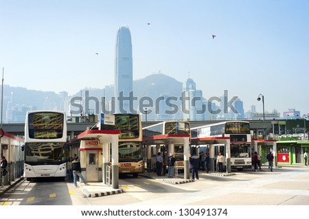 HONG KONG - JANUARY 14: Bus station on January 14, 2013 in  Hong Kong. With a land mass of 1,104 km and a population of 7 million people, Hong Kong is one of the most populated areas in the world