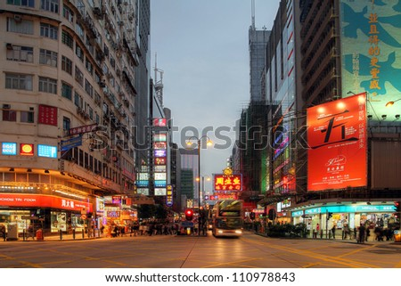 HONG KONG - JANUARY 4: Evening on Nathan Road, Kowloon, Hong-Kong, China on January 4, 2012. Nathan Road is the main throughfare of Kowloon lined with shops and restaurants and popular with tourists.