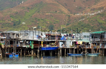 HONG KONG - JANUARY 31: Floating village on January 31, 2007, at Tai O, Hong Kong. Thousands of people are living on boats in the pay and cover their daily needs from fishing and tourism.