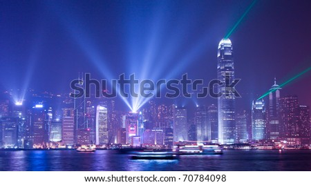 HONG KONG - JANUARY 9: Hong Kong's famous laser light show in Victoria Harbour on January 9, 2011 in Hong Kong