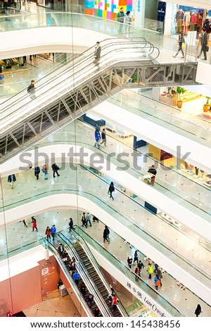 HONG KONG - JANUARY 15: Times Square is a major shopping centre on January 15, 2013 in Hong Kong. Consists of 83,700 m² of retail space, and two office towers with 102,300 m² of accommodation. - stock photo