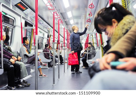 HONG KONG - JANUARY 21: Unidentified people inside a subway train on January 21, 2013 in Hong Kong. MTR had 46.4% of the public transport market, making it the most popular transport in Hong Kong