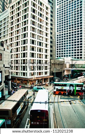 HONG KONG - JULY 30, 2012: Central District traffic and city life in this international financial center on July 30, 2012 in Hong Kong. The city is one of the most populated areas in the world