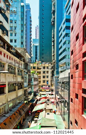 HONG KONG - JULY 30, 2012: view on downtown street on July 30, 2012 in Hong Kong. With a land mass of 1,104 km and 7 million people, Hong Kong is one of the most populated areas in the world