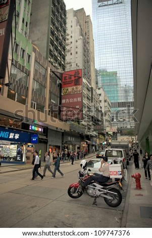 HONG KONG - MARCH 30: A busy street on March 30, 2012 in Hong Kong. With a land mass of 1,104 km2 and a population of 7 million people Hong Kong is one of the most densely populated areas in the world
