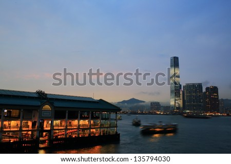 HONG KONG - MARCH 28: The ferry go to the International Commerce Centre in the evening, view from Hong Kong island in Kowloon on March 28 2013. ICC Tower is the tallest building in Hong Kong.