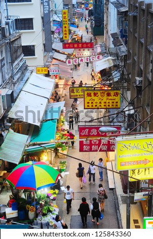 HONG KONG - MAY 21, 2012: Aerial view on street market on May 21, 2012 in Hong Kong. With a land mass of 1,104 km and population of 7 million people, Hong Kong is densely populated areas in the world