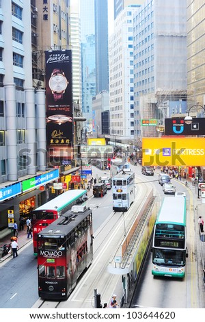 HONG KONG - MAY 21: Aerial view on street on May 21, 2012 in Hong Kong. With a land mass of 1,104 km and population of 7 million people, Hong Kong is one of  most densely populated areas in the world - stock photo