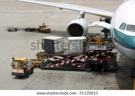 HONG KONG - MAY 16: Cargoes being unloaded from a Cathay aircraft at Hong Kong airport on May 16, 2009 in Hong Kong. Aside from China Airlines, Cathay is one of the most busy carriers in the region.