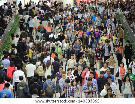 HONG KONG -MAY 13: Crowd of people, going in and out forward, in tunnel of Central MTR subway station on May 13 2013. 6 p.m. is the peak of rushing hour in central because all people come off work
