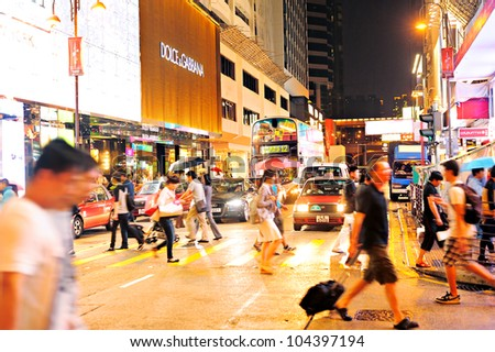 HONG KONG - MAY 19: Crowded street on May 19,2012 in Hong Kong. With a land mass of 1,104 km and population of 7 million people, Hong Kong is one of the most densely populated areas in the world