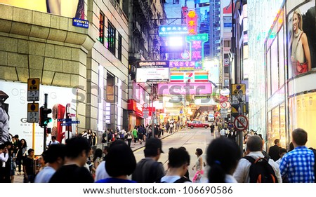 HONG KONG - MAY 21: Crowded street on May 21, 2012 in Hong Kong. With a land mass of 1,104 km and population of 7 million people, Hong Kong is one of the most densely populated areas in the world