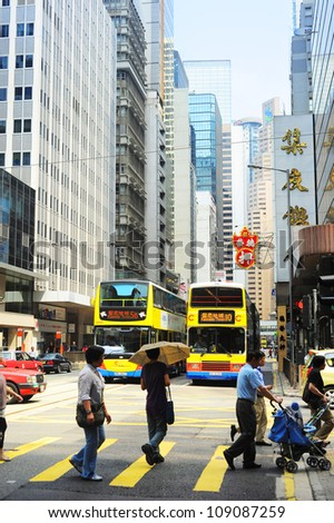 HONG KONG - MAY 22: Crowded street on May 22, 2012 in Hong Kong. With a land mass of 1,104 km and a population of 7 million people, Hong Kong is one of the most populated areas in the world