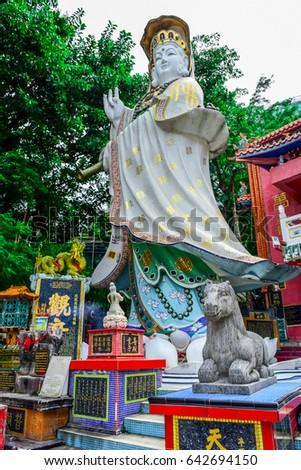 HONG KONG, MAY 31: Statues of Kwun Yam in Kwun Yam Shrine temple, a Taoist shrine at the southeastern end of Repulse Bay, Hong Kong Island #642694150