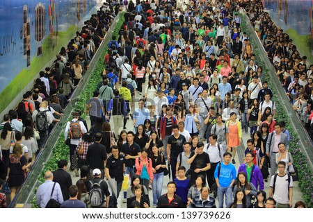 Hong Kong -May 13: The Crowd Of People In Tunnel Of Central Mtr Subway Station On May 13 2013. 6 P.M. Is The Peak Of Rushing Hour In Central Because All People Come Off Work