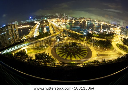 Hong Kong night traffic with modern buildings background - stock photo