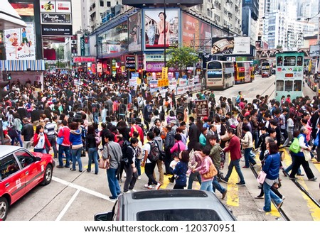 HONG KONG -NOV 24: Shoppers and visitors crowd at a shopping street on Nov 24, 2012 in Hong Kong, China. There are more than 35 million of visitors arrived Hong Kong from January to September 2012.