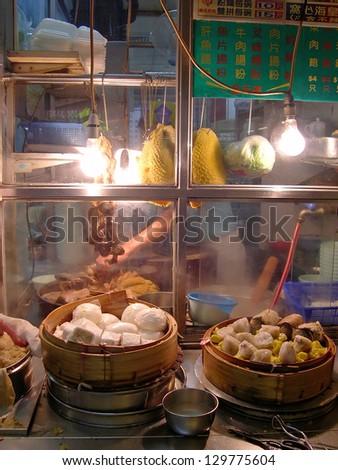 HONG KONG-Â?Â?NOVEMBER 20: Typical street restaurant.  With more than 12000 street stalls Hong Kong is one of the most vibrant food capitals in the world. November 20, 2005 in Hong Kong, China