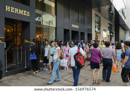 Hong Kong - Oct 01:The Luxury Shop Outlook, Full Of Tourists In Hong Kong On 01 October 2013. The Rise In Rmb Make Chinese Purchase Luxury Product.