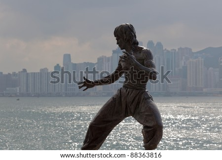 HONG KONG - OCTOBER 01: Bruce Lee statue on the Avenue of Stars on October 01, 2010 in Tsim Sha Tsui, Hong Kong. The statue is one of the main attractions on the famous waterfront promenade. - stock photo