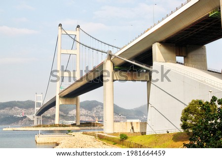 Hong Kong's Tsing Ma Bridge, one of the world's longest suspension bridges, and the longest in the world carrying rail traffic. The bridge is an important gateway to Lantau Island. Photo stock ©