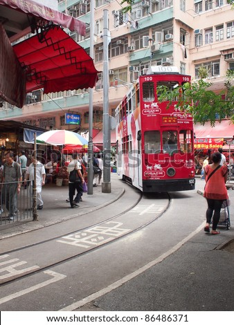 HONG KONG - SEPT 21: Unidentified people use city tram on September 21, 2010. Hong Kong tram is the only system in the world run with double deckers and one of the main tourist attractions.