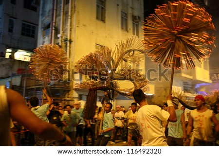 HONG KONG - SEPTEMBER 29 : The fire dragon dance is performed at Tai Hang, Hong Kong  on the eve of the Mid-Autumn Festival, Sept. 29, 2012.It is one the  Chinese intangible cultural heritage.