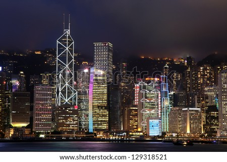 Hong Kong skyline at night against peak Victoria