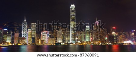 Hong Kong skyline at night over Victoria harbor
