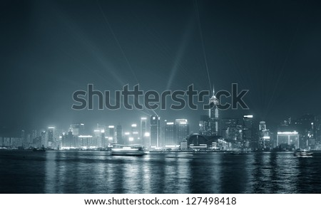 Hong Kong skyline at night with lights and skyscrapers with laser beams black and white