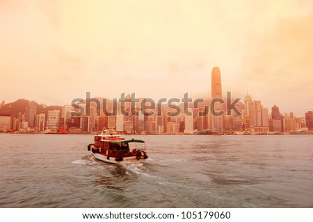 Hong Kong skyline in the morning over Victoria Harbour in red tone.