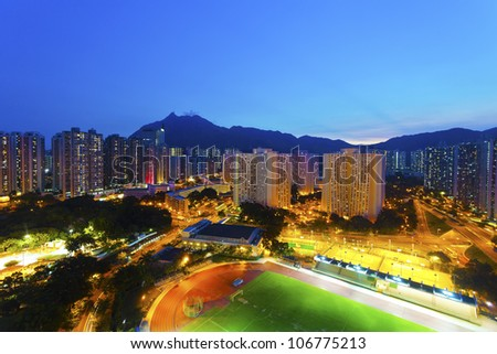 Hong Kong sunset with crowded buildings background