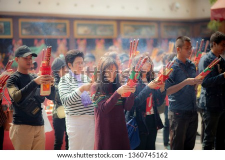 hongkong china - march16,2019 : large number of asian people praying to buddhist shrine with incenses in hongkong city religion traveling destination  #1360745162