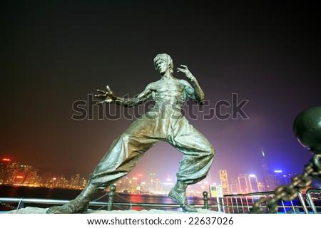 Hongkong,CN-Dec 15 :bruce lee's  statue at night in Hong Kong's Vicotria harbour Dec 15,2008 in Hongkong ,CN