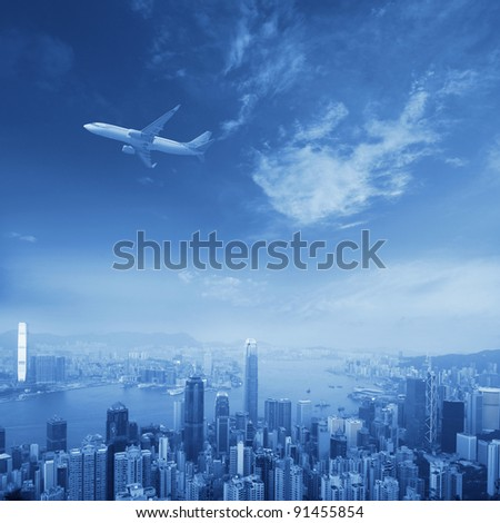 hongkong's skyscrapers and airplanes on sky - stock photo