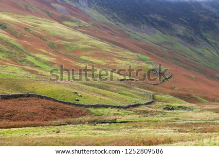 Honister Pass, a mountain pass with a winding road along side a slate mine, in the Borrowdale Valley, Cumbria, in the Lake District of England, one of the steepest and highest passes in the region. #1252809586
