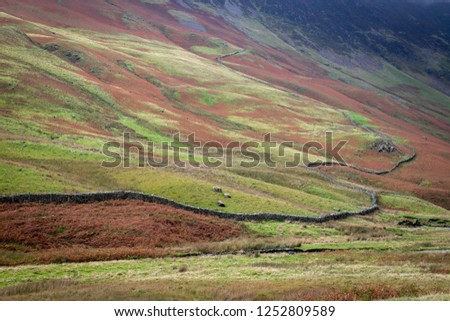 Honister Pass, a mountain pass with a winding road along side a slate mine, in the Borrowdale Valley, Cumbria, in the Lake District of England, one of the steepest and highest passes in the region. #1252809589