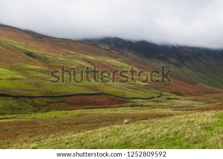 Honister Pass, a mountain pass with a winding road along side a slate mine, in the Borrowdale Valley, Cumbria, in the Lake District of England, one of the steepest and highest passes in the region. #1252809592