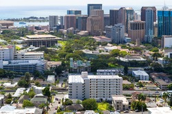 Honolulu downtown and city centre, Oahu, Hawaii. Hawaii State Capitol building centre left, before Honolulu Harbor.