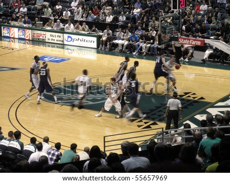 HONOLULU, HI - FEBRUARY 27: Nevada 63 vs. Hawaii 74:UH player drives to the basket as his teammate runs a screen February 27, 2010 at the Stan Sheriff Center in Honolulu, Hawaii. - stock photo