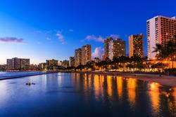 Honolulu skyline and Waikiki beach at twilight, Hawaii. USA