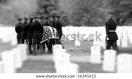 Honor Guard bearing casket to grave at Arlington National Cemetery