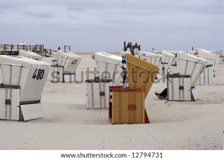 Hooded beach chairs near North Sea in Germany