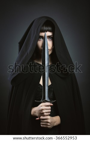 Stock Photo Hooded beautiful assassin. Dark fantasy