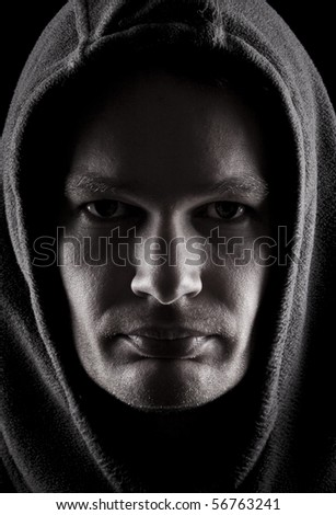Hooded crim with stubble and a hoody