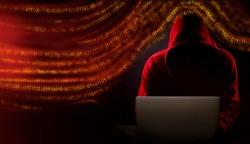 hooded hacker solar winds hack concept