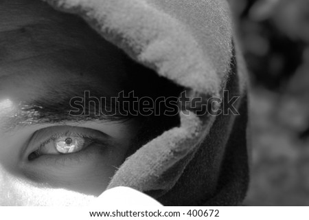 Hooded man with a bright eye