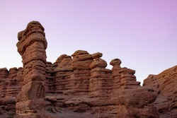 Hoodoo desert rock formations in San Lorenzo Canyon landscape at sunset. The canyon is outside of Socorro, New Mexico, USA