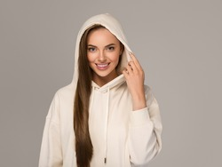 Hoody woman with long smooth hair beautiful young model portrait